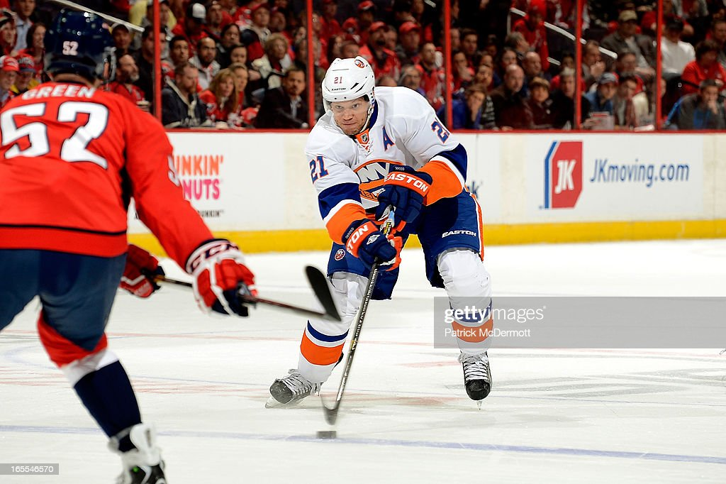 <a gi-track='captionPersonalityLinkClicked' href=/galleries/search?phrase=Kyle+Okposo&family=editorial&specificpeople=540469 ng-click='$event.stopPropagation()'>Kyle Okposo</a> #21 of the New York Islanders brings the puck into the zone during an NHL game against the Washington Capitals at Verizon Center on April 4, 2013 in Washington, DC.