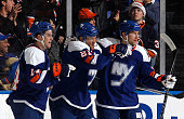 Kyle Okposo of the New York Islanders celebrates his first period goal against the Montreal Canadiens with Thomas Hickey and Josh Bailey at Nassau...
