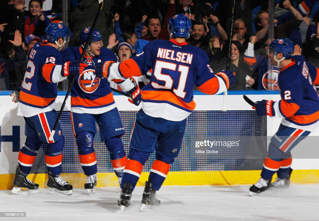 <a gi-track='captionPersonalityLinkClicked' href=/galleries/search?phrase=Kyle+Okposo&family=editorial&specificpeople=540469 ng-click='$event.stopPropagation()'>Kyle Okposo</a> #21 of the New York Islanders celebrates his game tying goal with teammates <a gi-track='captionPersonalityLinkClicked' href=/galleries/search?phrase=Josh+Bailey+-+Ice+Hockey+Player&family=editorial&specificpeople=3321456 ng-click='$event.stopPropagation()'>Josh Bailey</a> #12, <a gi-track='captionPersonalityLinkClicked' href=/galleries/search?phrase=Frans+Nielsen&family=editorial&specificpeople=634894 ng-click='$event.stopPropagation()'>Frans Nielsen</a> #51, and <a gi-track='captionPersonalityLinkClicked' href=/galleries/search?phrase=Mark+Streit&family=editorial&specificpeople=636976 ng-click='$event.stopPropagation()'>Mark Streit</a> #2 during the game against the Toronto Maple Leafs at Nassau Veterans Memorial Coliseum on February 28, 2013 in Uniondale, New York. The Maple Leafs defeated the Islanders 5-4 in overtime.