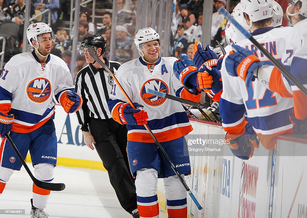 <a gi-track='captionPersonalityLinkClicked' href=/galleries/search?phrase=Kyle+Okposo&family=editorial&specificpeople=540469 ng-click='$event.stopPropagation()'>Kyle Okposo</a> #21 of the New York Islanders celebrates his goal with the bench during the third period against the Pittsburgh Penguins in Game Two of the Eastern Conference Quarterfinals during the 2013 NHL Stanley Cup Playoffs at Consol Energy Center on May 3, 2013 in Pittsburgh, Pennsylvania. New York won the game 4-3.