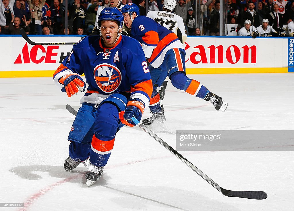 Kyle Okposo of the New York Islanders celebrates his third goal of the game in the third period against the Pittsburgh Penguins at Nassau Veterans...