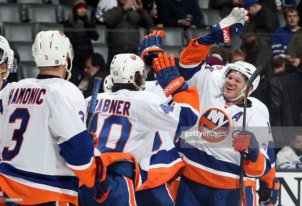 <a gi-track='captionPersonalityLinkClicked' href=/galleries/search?phrase=Kyle+Okposo&family=editorial&specificpeople=540469 ng-click='$event.stopPropagation()'>Kyle Okposo</a> #21 of the New York Islanders celebrates the win against the Toronto Maple Leafs during NHL action at the Air Canada Centre January 24, 2013 in Toronto, Ontario, Canada.
