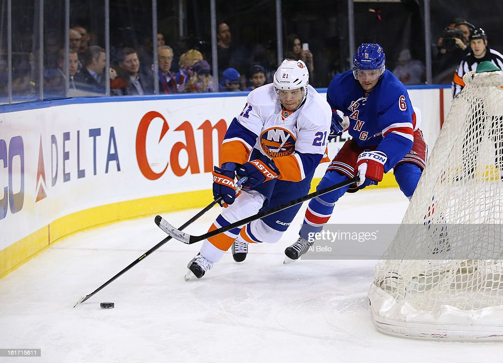<a gi-track='captionPersonalityLinkClicked' href=/galleries/search?phrase=Kyle+Okposo&family=editorial&specificpeople=540469 ng-click='$event.stopPropagation()'>Kyle Okposo</a> #21 of the New York Islanders in action against <a gi-track='captionPersonalityLinkClicked' href=/galleries/search?phrase=Anton+Stralman&family=editorial&specificpeople=2271901 ng-click='$event.stopPropagation()'>Anton Stralman</a> #6 of the New York Rangers during their game at Madison Square Garden on February 7, 2013 in New York City.