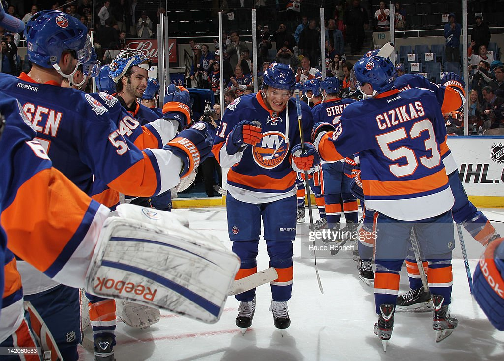 Kyle Okposo #21 of the New York Islanders in named one of the stars of the game against the Pittsburgh Penguins and skates through the guantlet at the Nassau Veterans Memorial Coliseum on March 29, 2012 in Uniondale, New York. The Islanders defeated the Penguins 5-3.