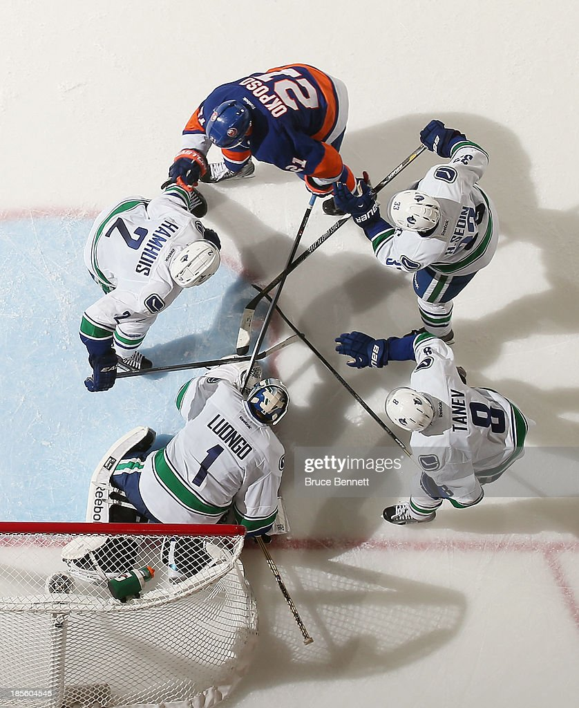 <a gi-track='captionPersonalityLinkClicked' href=/galleries/search?phrase=Kyle+Okposo&family=editorial&specificpeople=540469 ng-click='$event.stopPropagation()'>Kyle Okposo</a> #21 of the New York Islanders is stopped by the Vancouver Canucks at the Nassau Veterans Memorial Coliseum on October 22, 2013 in Uniondale, New York. The Canucks defeated the Islanders 5-4 in overtime.