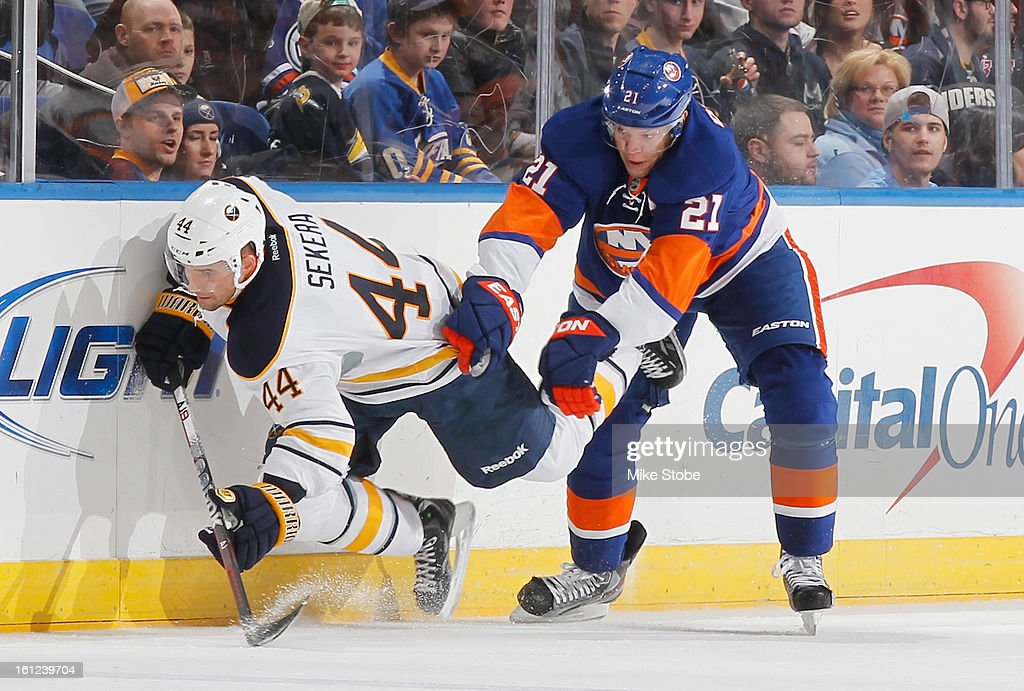Kyle Okposo #21 of the New York Islanders pursues the puck against Andrej Sekera #44 of the Buffalo Sabres at Nassau Veterans Memorial Coliseum on Febuary 9, 2013 in Uniondale, New York. The Sabres defeated the Islanders 3-2.