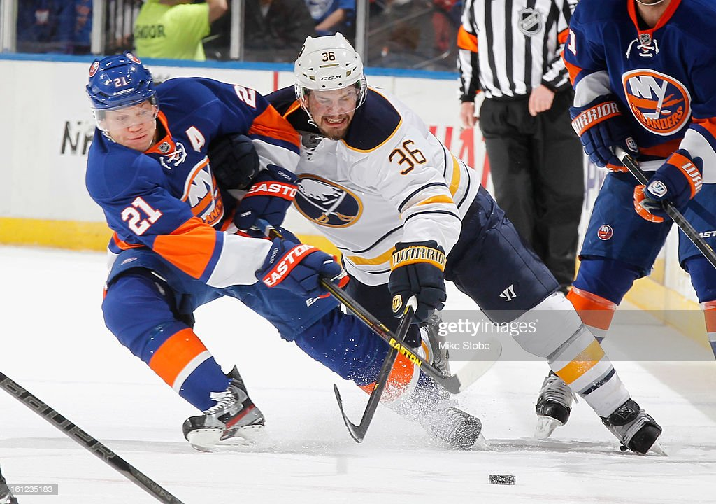 Kyle Okposo #21 of the New York Islanders pursues the puck against Patrick Kaleta #36 of the Buffalo Sabres at Nassau Veterans Memorial Coliseum on Febuary 9, 2013 in Uniondale, New York.