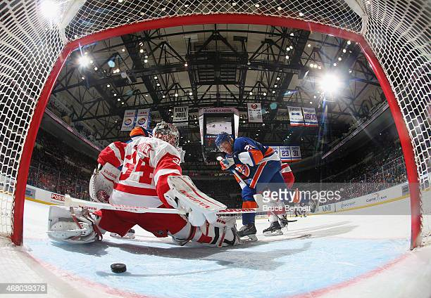Kyle Okposo of the New York Islanders scores a powerplay goal at 902 of the first period against Petr Mrazek of the Detroit Red Wings at the Nassau...