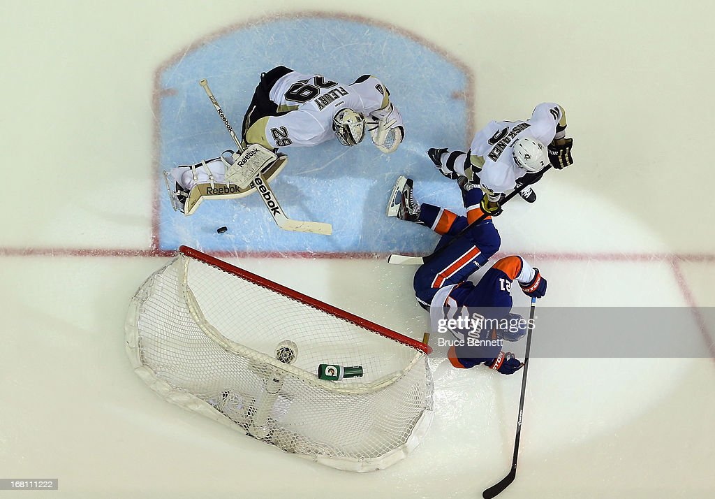 <a gi-track='captionPersonalityLinkClicked' href=/galleries/search?phrase=Kyle+Okposo&family=editorial&specificpeople=540469 ng-click='$event.stopPropagation()'>Kyle Okposo</a> #21 of the New York Islanders scores a shorthanded goal at 5:31 of the third period against Marc-Andre Fleury #29 of the Pittsburgh Penguins in Game Three of the Eastern Conference Quarterfinals during the 2013 NHL Stanley Cup Playoffs at the Nassau Veterans Memorial Coliseum on May 5, 2013 in Uniondale, New York.