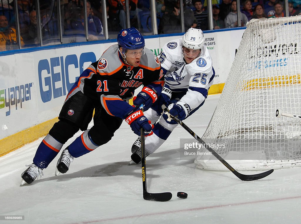 <a gi-track='captionPersonalityLinkClicked' href=/galleries/search?phrase=Kyle+Okposo&family=editorial&specificpeople=540469 ng-click='$event.stopPropagation()'>Kyle Okposo</a> #21 of the New York Islanders skates against the Tampa Bay Lightning at the Nassau Veterans Memorial Coliseum on April 6, 2013 in Uniondale, New York. The Islanders defeated the Lightning 4-2.