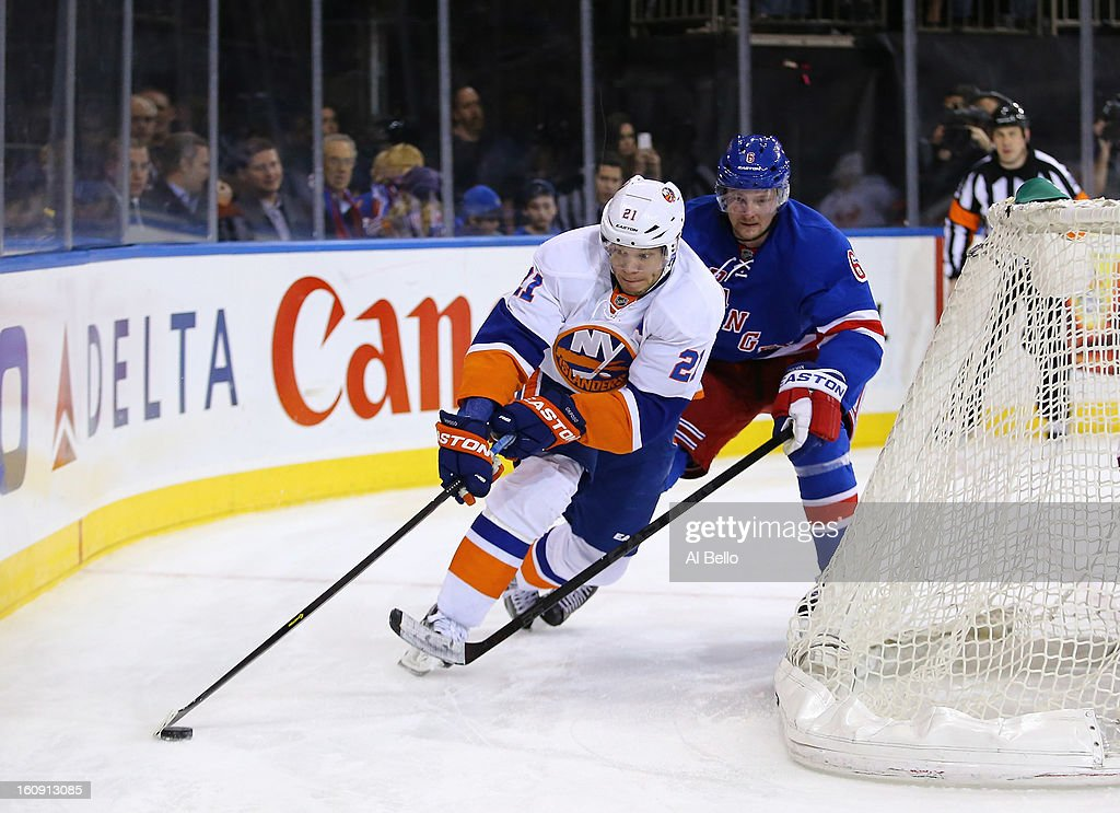 <a gi-track='captionPersonalityLinkClicked' href=/galleries/search?phrase=Kyle+Okposo&family=editorial&specificpeople=540469 ng-click='$event.stopPropagation()'>Kyle Okposo</a> #21 of the New York Islanders skates with the puck as <a gi-track='captionPersonalityLinkClicked' href=/galleries/search?phrase=Anton+Stralman&family=editorial&specificpeople=2271901 ng-click='$event.stopPropagation()'>Anton Stralman</a> #6 of the New York Rangers follows during their game at Madison Square Garden on February 7, 2013 in New York City.