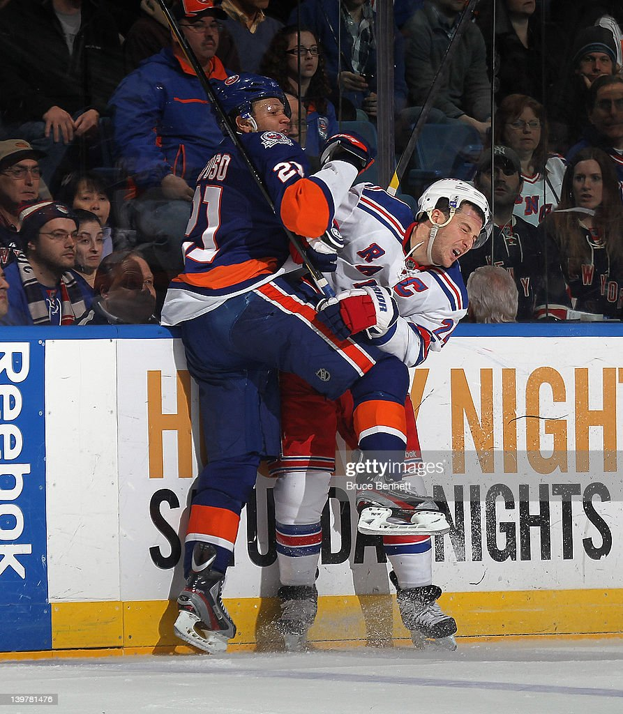 <a gi-track='captionPersonalityLinkClicked' href=/galleries/search?phrase=Kyle+Okposo&family=editorial&specificpeople=540469 ng-click='$event.stopPropagation()'>Kyle Okposo</a> #21 of the New York Islanders takes a penalty in the third period for elbowing <a gi-track='captionPersonalityLinkClicked' href=/galleries/search?phrase=Ryan+Callahan&family=editorial&specificpeople=809690 ng-click='$event.stopPropagation()'>Ryan Callahan</a> #24 of the New York Rangers at the Nassau Veterans Memorial Coliseum on February 24, 2012 in Uniondale, New York. The Islanders defeated the Rangers 4-3 in the shootout.
