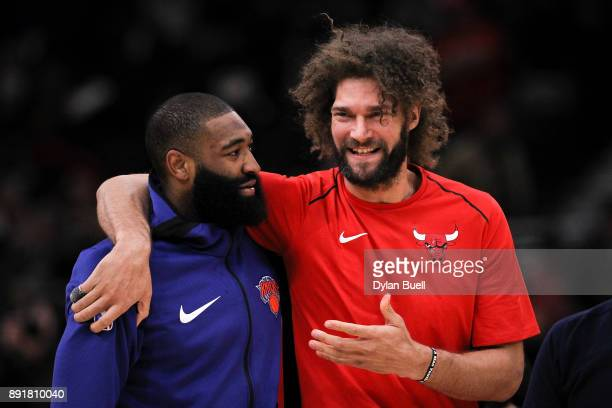 Kyle O'Quinn of the New York Knicks and Robin Lopez of the Chicago Bulls meet before the game at the United Center on December 9 2017 in Chicago...