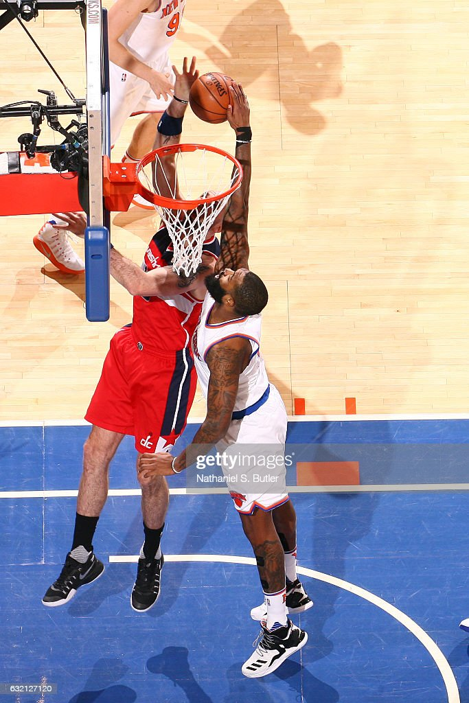 Kyle O'Quinn #9 of the New York Knicks blocks the shot against Marcin Gortat #13 of the Washington Wizards on January 19, 2017 at Madison Square Garden in New York City, New York.
