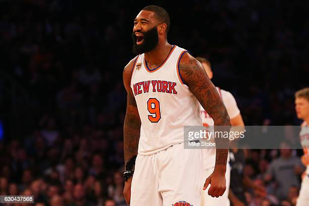 Kyle O'Quinn of the New York Knicks celebrates a basket against the Orlando Magic at Madison Square Garden on December 22 2016 in New York City