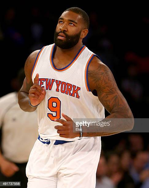 Kyle O'Quinn of the New York Knicks celebrates his basket in the first half of a preseason exhibition game against Paschoalotto Bauru at Madison...