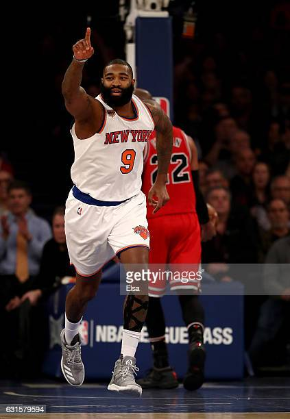 Kyle O'Quinn of the New York Knicks celebrates his dunk in the second half against the Chicago Bulls at Madison Square Garden on January 12 2017 in...