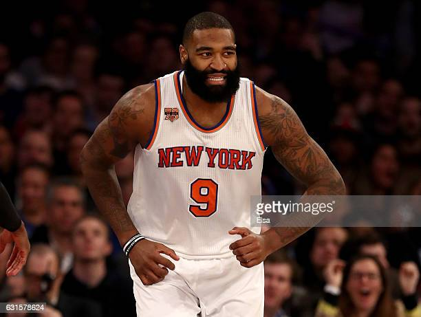 Kyle O'Quinn of the New York Knicks celebrates in the fourth quarter against the Chicago Bulls at Madison Square Garden on January 12 2017 in New...