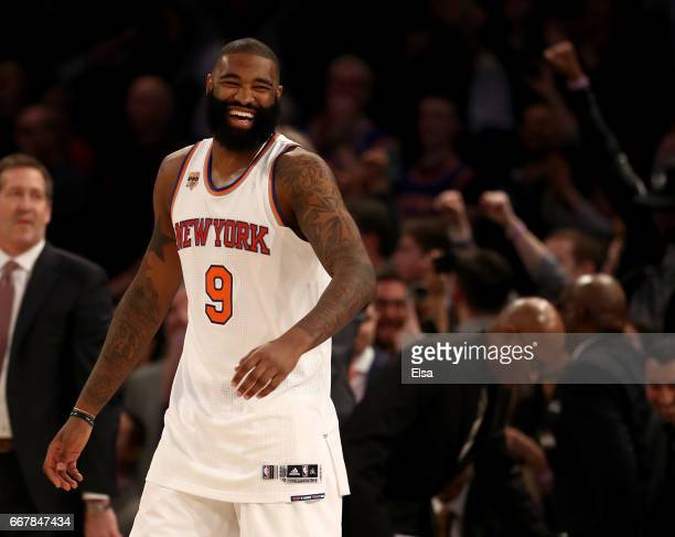 Kyle O'Quinn of the New York Knicks celebrates the 114113 win over the Philadelphia 76ers at Madison Square Garden on April 12 2017 in New York City...