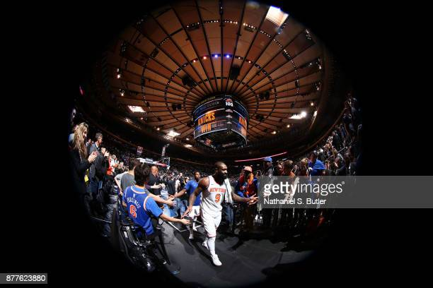 Kyle O'Quinn of the New York Knicks exchanges high fives with fans after the game against the Toronto Raptors on November 22 2017 at Madison Square...