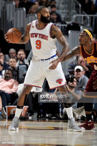 Kyle O'Quinn of the New York Knicks handles the ball against the Cleveland Cavaliers on February 23 2017 at Quicken Loans Arena in Cleveland Ohio...