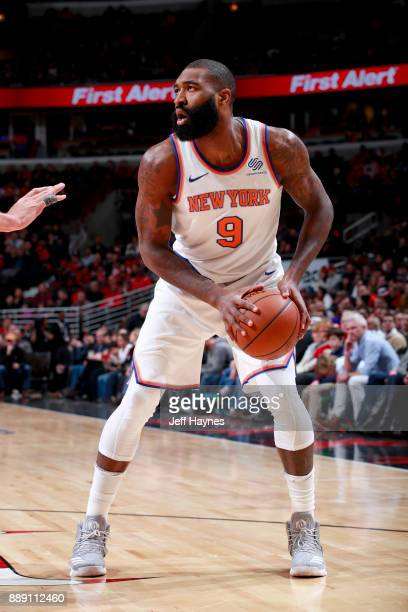 Kyle O'Quinn of the New York Knicks handles the ball against the Chicago Bulls on December 9 2017 at the United Center in Chicago Illinois NOTE TO...