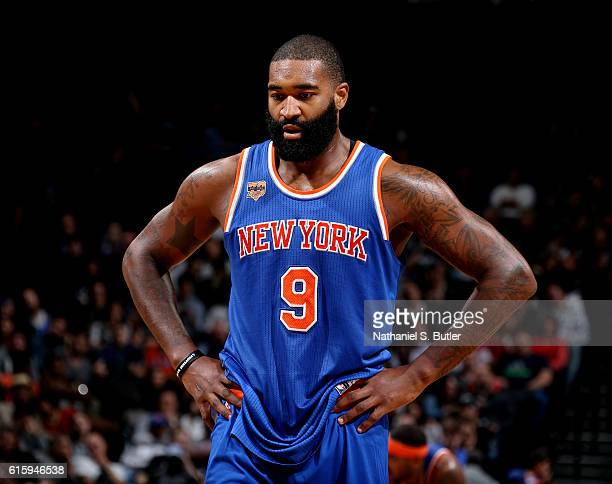 Kyle O'Quinn of the New York Knicks looks on against the Brooklyn Nets during a preseason game on October 20 2016 at Barclays Center in Brooklyn New...