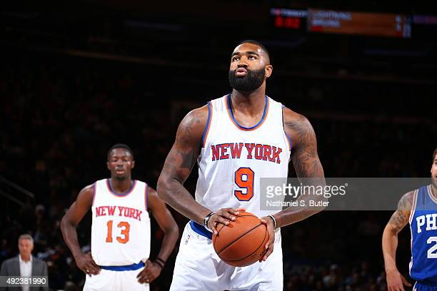 Kyle O'Quinn of the New York Knicks prepares to shoot a free throw against the Philadelphia 76ers on October 12 2015 at Madison Square Garden in New...