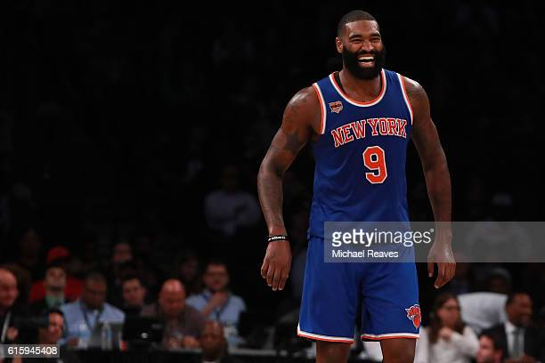 Kyle O'Quinn of the New York Knicks reacts against the Brooklyn Nets during the second half of their preseason game at Barclays Center on October 20...