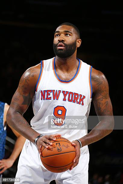 Kyle O'Quinn of the New York Knicks shoots a free throw against Paschoalotto/Bauru during a preseason game on October 7 2015 at Madison Square Garden...
