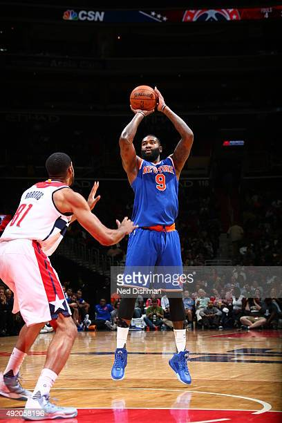 Kyle O'Quinn of the New York Knicks shoots against the Washington Wizards during a preseason game on October 9 2015 at Verizon Center in Washington...