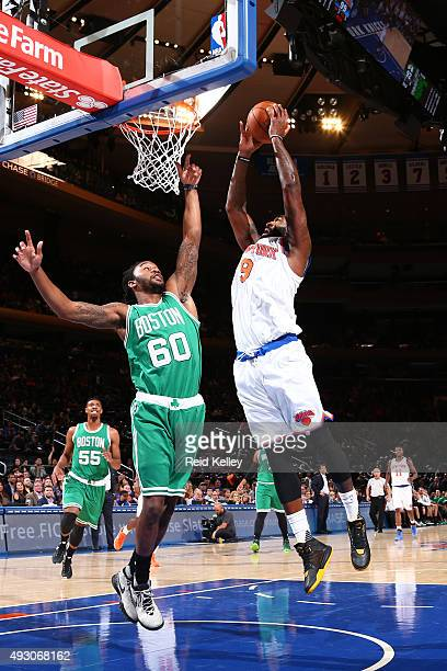 Kyle O'Quinn of the New York Knicks shoots the ball against the Boston Celtics during a preseason game on October 16 2015 at Madison Square Garden in...