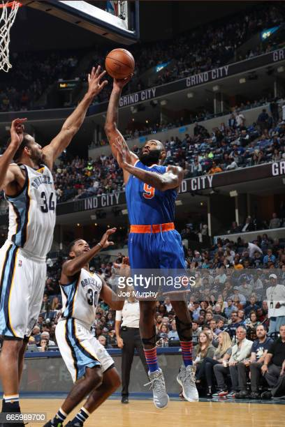 Kyle O'Quinn of the New York Knicks shoots the ball during a game against the Memphis Grizzlies on April 7 2017 at FedExForum in Memphis Tennessee...
