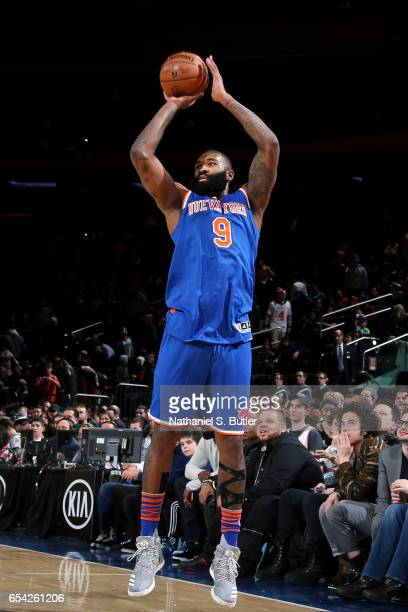 Kyle O'Quinn of the New York Knicks shoots the ball during the game against the Brooklyn Nets on March 16 2017 at Madison Square Garden in New York...