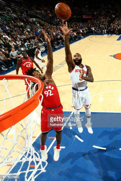 Kyle O'Quinn of the New York Knicks shoots the ball during the game against the Toronto Raptors on November 22 2017 at Madison Square Garden in New...