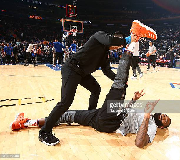 Kyle O'Quinn of the New York Knicks stretches on court before the game against the Memphis Grizzlies on October 29 2016 at Madison Square Garden in...