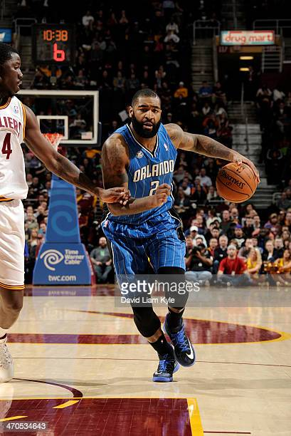 Kyle O'Quinn of the Orlando Magic drives to the basket against Henry Sims of the Cleveland Cavaliers at The Quicken Loans Arena on February 19 2014...