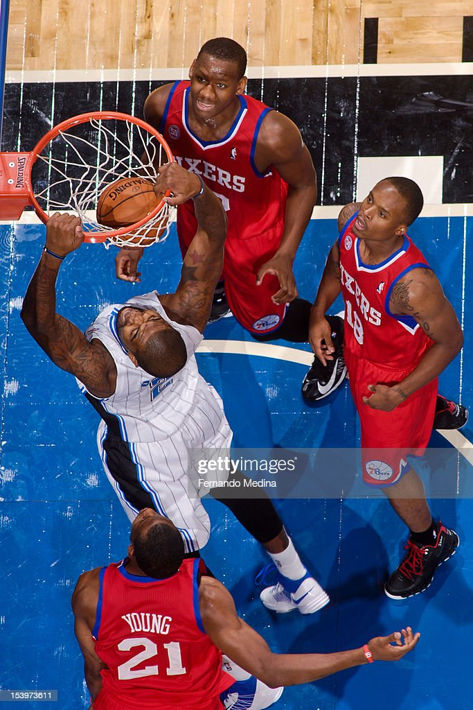 Kyle O'Quinn #2 of the Orlando Magic dunks against Philadelphia 76ers players <a gi-track='captionPersonalityLinkClicked' href=/galleries/search?phrase=Lavoy+Allen&family=editorial&specificpeople=4628334 ng-click='$event.stopPropagation()'>Lavoy Allen</a> #50, Maalik Wayns #18 and <a gi-track='captionPersonalityLinkClicked' href=/galleries/search?phrase=Thaddeus+Young&family=editorial&specificpeople=3847270 ng-click='$event.stopPropagation()'>Thaddeus Young</a> #21 during a pre-season game on October 11, 2012 at Amway Center in Orlando, Florida.