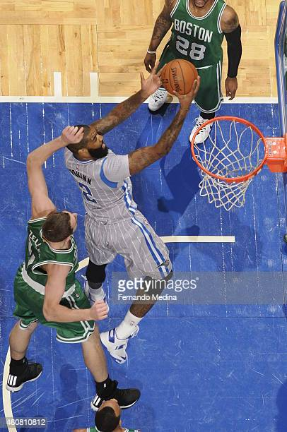 Kyle O'Quinn of the Orlando Magic goes to the basket against the Boston Celtics on December 23 2014 at Amway Center in Orlando Florida NOTE TO USER...