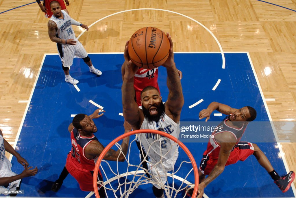 <a gi-track='captionPersonalityLinkClicked' href=/galleries/search?phrase=Kyle+O%27Quinn&family=editorial&specificpeople=9027719 ng-click='$event.stopPropagation()'>Kyle O'Quinn</a> #2 of the Orlando Magic goes up for the dunk against the Washington Wizards during the game on April 11, 2014 at Amway Center in Orlando, Florida.