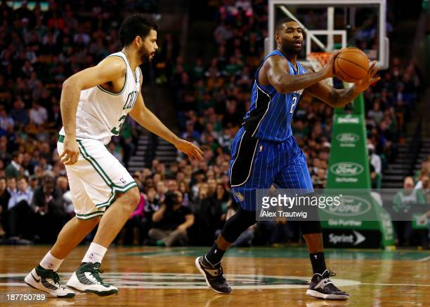 Kyle O'Quinn of the Orlando Magic looks to pass as Vitor Faverani of the Boston Celtics defends during a game at the TD Garden on November 11 2013 in...
