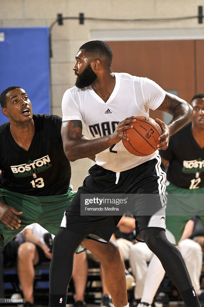Kyle O'Quinn #2 of the Orlando Magic protects the ball from Fab Melo #13 of the Boston Celtics during the 2013 Southwest Airlines Orlando Pro Summer League game between the Boston Celtics and the Orlando Magic on July 7, 2013 at Amway Center in Orlando, Florida.