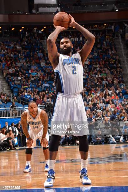 Kyle O'Quinn of the Orlando Magic shoots a foul shot against the Utah Jazz during the game on December 18 2013 at Amway Center in Orlando Florida...