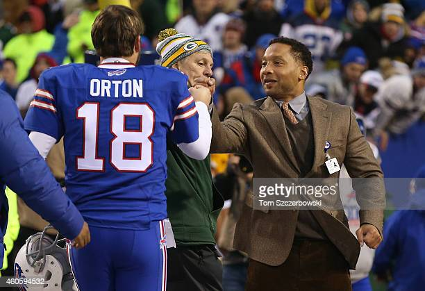 Kyle Orton of the Buffalo Bills is congratulated by general manager Doug Whaley after their victory during NFL game action against the Green Bay...
