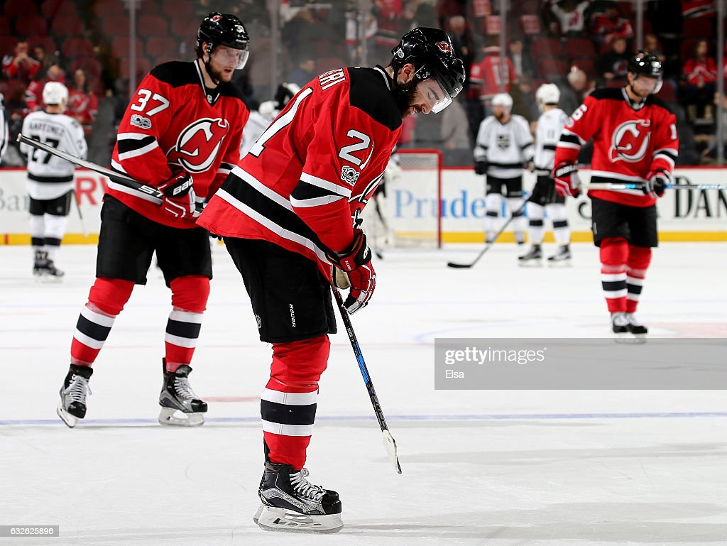 1decaabd894 21 Home Red Reebok Authentic New Jersey Devils NHL Jersey Kyle Palmieri 21  and Pavel Zacha 37 of the New Jersey Devils react to ...
