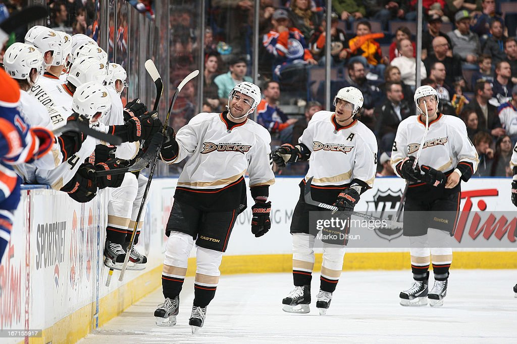 <a gi-track='captionPersonalityLinkClicked' href=/galleries/search?phrase=Kyle+Palmieri&family=editorial&specificpeople=4783296 ng-click='$event.stopPropagation()'>Kyle Palmieri</a> #51 and Teemu Selanne #8 of the Anaheim Ducks celebrate with teammates after a goal in a game against the Edmonton Oilers on April 21, 2013 at Rexall Place in Edmonton, Alberta, Canada.