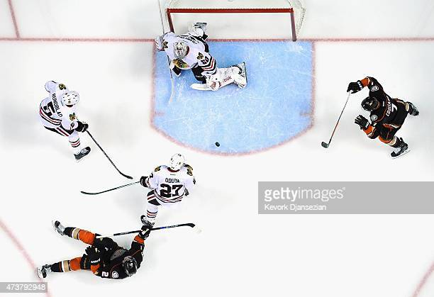 Kyle Palmieri of the Anaheim Ducks and teammate Andrew Cogliano watch the puck get past Johnny Oduya David Rundblad and eventually goaltender Corey...