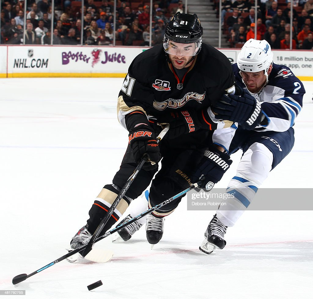 <a gi-track='captionPersonalityLinkClicked' href=/galleries/search?phrase=Kyle+Palmieri&family=editorial&specificpeople=4783296 ng-click='$event.stopPropagation()'>Kyle Palmieri</a> #21 of the Anaheim Ducks battles for the puck against <a gi-track='captionPersonalityLinkClicked' href=/galleries/search?phrase=Adam+Pardy&family=editorial&specificpeople=2221762 ng-click='$event.stopPropagation()'>Adam Pardy</a> #2 of the Winnipeg Jets on March 31, 2014 at Honda Center in Anaheim, California.