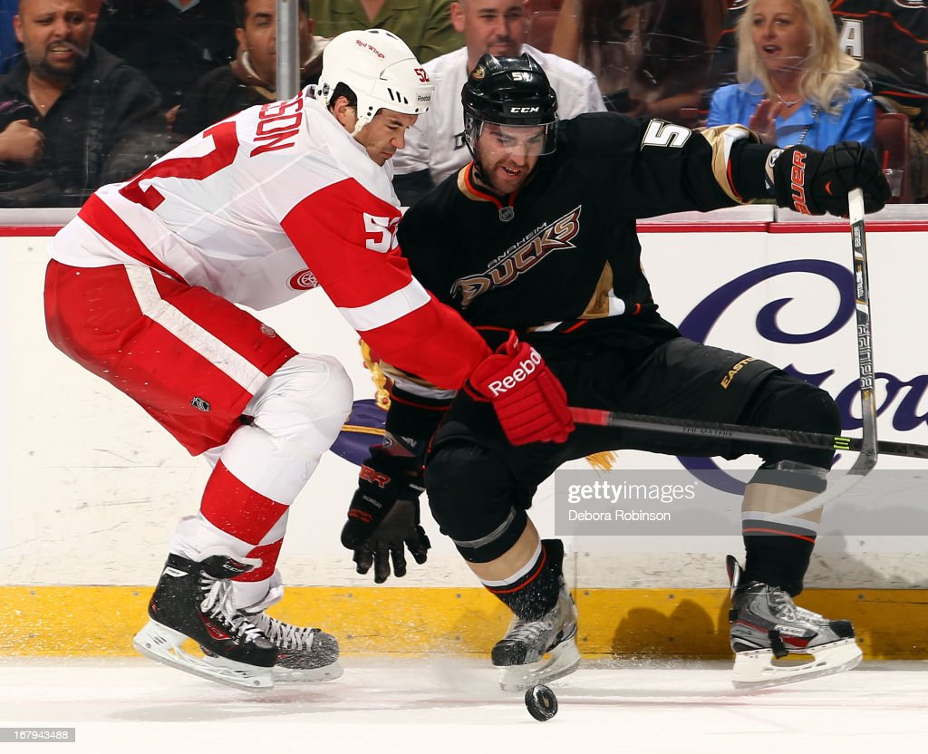 <a gi-track='captionPersonalityLinkClicked' href=/galleries/search?phrase=Kyle+Palmieri&family=editorial&specificpeople=4783296 ng-click='$event.stopPropagation()'>Kyle Palmieri</a> #51 of the Anaheim Ducks battles for the puck against <a gi-track='captionPersonalityLinkClicked' href=/galleries/search?phrase=Jonathan+Ericsson&family=editorial&specificpeople=2538498 ng-click='$event.stopPropagation()'>Jonathan Ericsson</a> #52 of the Detroit Red Wings in Game Two of the Western Conference Quarterfinals during the 2013 NHL Stanley Cup Playoffs at Honda Center on May 2, 2013 in Anaheim, California.