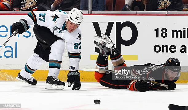 Kyle Palmieri of the Anaheim Ducks battles for the puck against Scott Hannan of the San Jose Sharks on April 9 2014 at Honda Center in Anaheim...